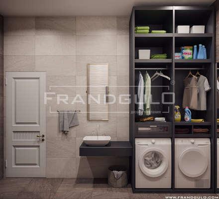 Просторная и стильная прачечная в апартаментах: Ванные комнаты в . Автор – Frandgulo