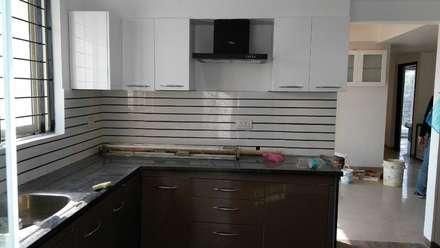 Mr. Udaybhan Singh Thakur Retirement Home: minimalistic Kitchen by al-Haadi Interiors
