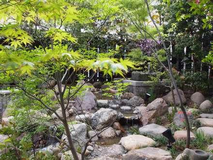 Estanques de jardín de estilo  por 空間工房 欅