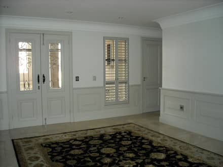 Wall panels, Custom front door, shutters and wrought iron gates:  Corridor & hallway by CKW Lifestyle