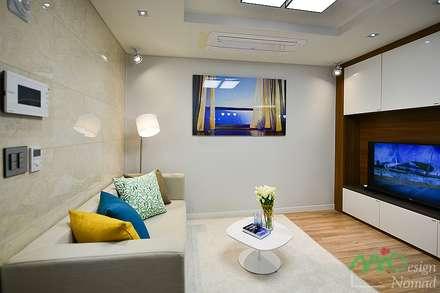 부산 분양 모델하우스 세팅, 산토리니 스타일 - 노마드디자인: 노마드디자인 / Nomad design의  거실