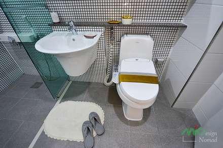 부산 분양 모델하우스 세팅, 클래식 스타일 - 노마드디자인: 노마드디자인 / Nomad design의  화장실