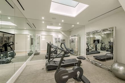 Basement - Gym Conversion: modern Gym by SJ Construction London