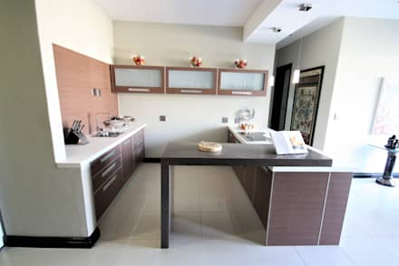 counter of the kitchen:  Built-in kitchens by Nuclei Lifestyle Design