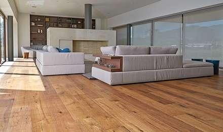 Sala en casa en la Pradera de Potosi : Salas de estilo rústico por Pisos Millenium