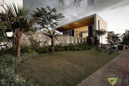 Casas unifamiliares de estilo  por Olaa Arquitetos