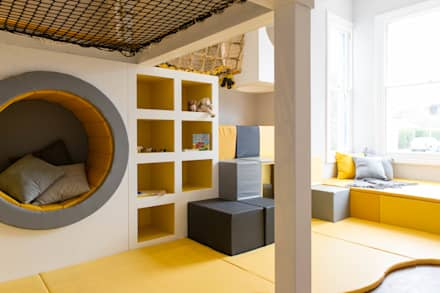 The timber structure offers seating, storage, play and more.: scandinavian Nursery/kid's room by Tigerplay at Home