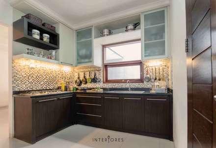 Dapur Kotor:  Dapur by INTERIORES - Interior Consultant & Build