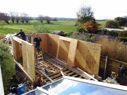 Erection of Walls:  Prefabricated home by Building With Frames