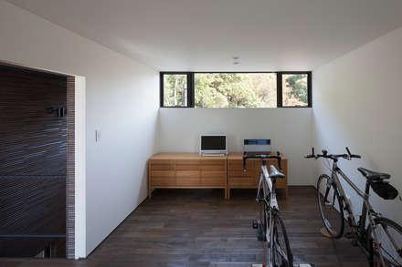 趣味の部屋: (株)建築デザイン研究所が手掛けた壁です。