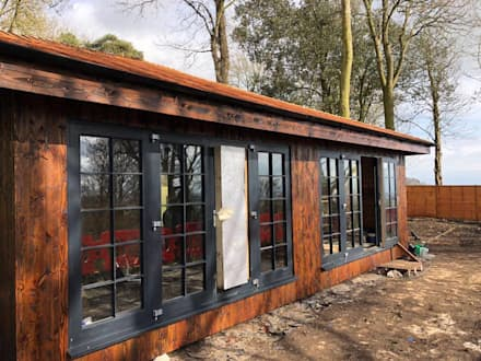 Exterior Glazing:  Wooden houses by Building With Frames