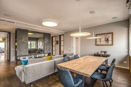 ISIDORO: Sala da pranzo in stile in stile Moderno di MOB ARCHITECTS