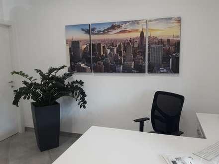 Ristrutturazione uffici Banca: Spazi commerciali in stile  di Contemporaneo Interior