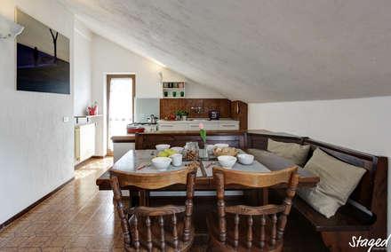 RESTYLING DI ARREDO PER L'AFFITTO: Sala da pranzo in stile in stile Rustico di Staged Interiors srls