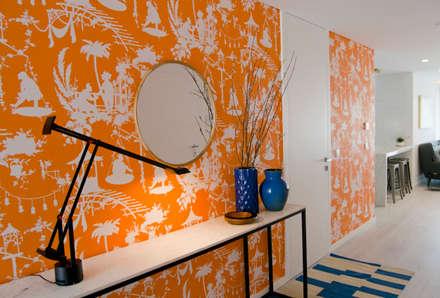 Hall de entrada: Corredores e halls de entrada  por Tangerinas e Pêssegos
