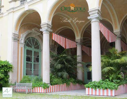 Belle Epoque: Giardino d'inverno in stile in stile Classico di MASSIMO SEMOLA PROGETTAZIONE GIARDINI MILANO