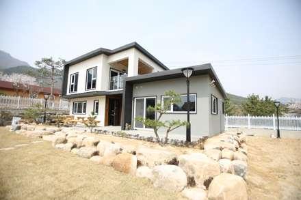 김해 여차리 단독주택 : 한솔E&C(한솔건축)의  목조 주택