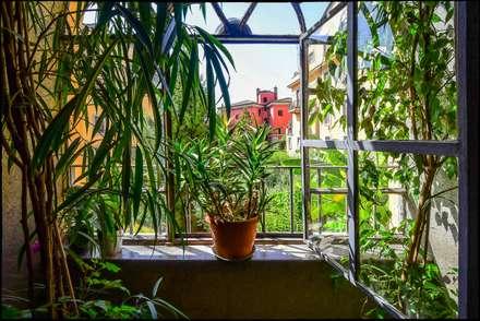 Jardines de invierno de estilo ecléctico por Arabella Rocca Architettura e Design