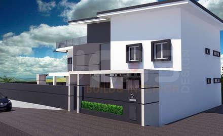 cheras double storey house:  Terrace house by Yucas Design & Build Sdn. Bhd.