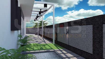 Jardins de fachada  por Yucas Design & Build Sdn. Bhd.
