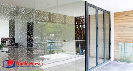 Glass doors by PT. Podomoro Windownesia