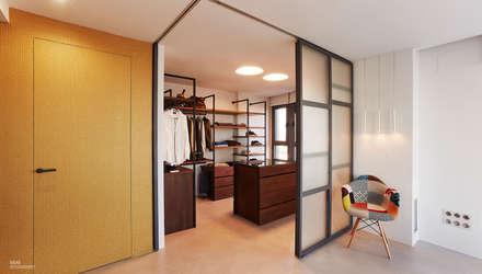 Un ático con estilo: Vestidores de estilo moderno de Ideas Interiorismo Exclusivo, SLU