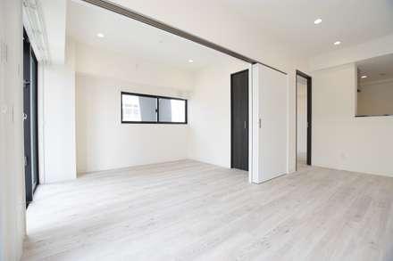 賃貸住宅: Style Create   有限会社 秀林組が手掛けた寝室です。