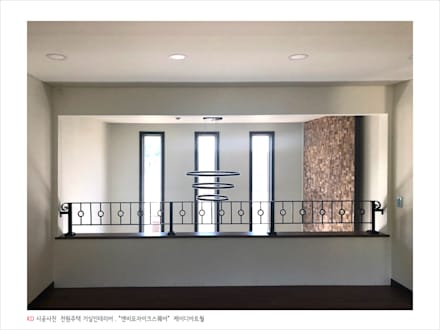 케이디아트월 , 엔비스퀘어 우드타일 시공사례, 경기도 양주 전원주택 / 미래하우징: 케이디우드테크 의  거실