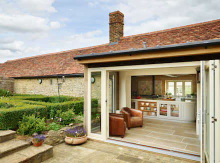 Restored Farmhouse:  Country house by Teddy Edwards