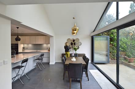 Architect designed roof and kitchen house extension Kingston KT2 - Dining area: eclectic Dining room by GOAStudio | London residential architecture