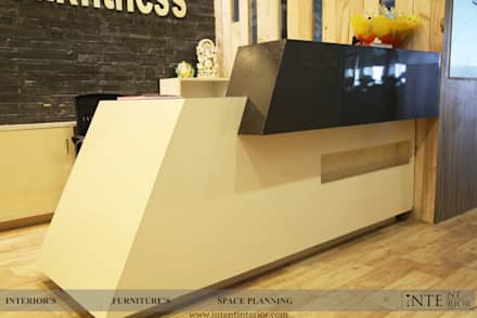 Reception  table: modern Gym by intent interior