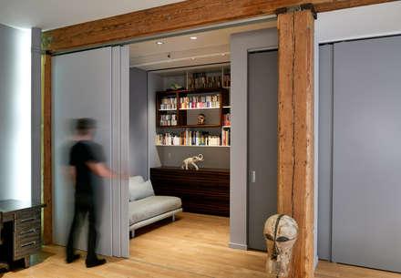 Soho Loft: modern Conservatory by KUBE Architecture
