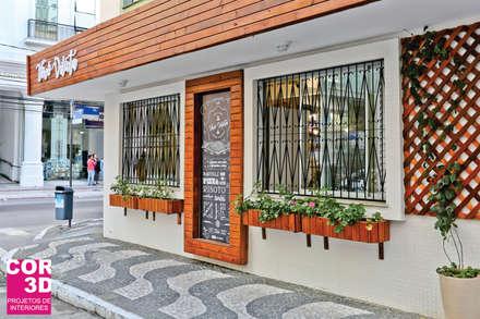 Locales gastronómicos de estilo  por Cor3D Projetos de Interiores