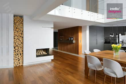 Wnętrza domu na Podhalu zaprojektowane przez Intellio designers: styl , w kategorii Salon zaprojektowany przez Intellio designers