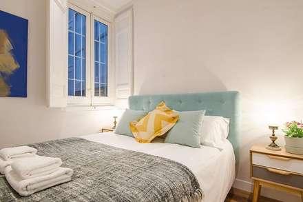 Dormitorio secundario de la vivienda de Inés: Dormitorios de estilo escandinavo de Rez estudio