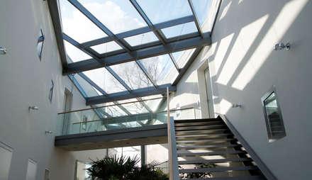 Treppe im Wintergarten:  Treppe von Architekturbüro Milan Schmitt