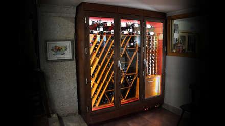 garrafeira climatizada exclusiva: Espaços de restauração  por Volo Vinis