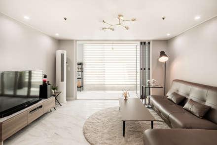 modern Living room by 봄디자인
