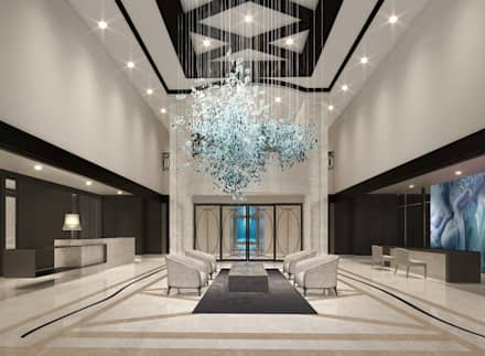 Recepción de un condominio : Hoteles de estilo  por Claudia Luján