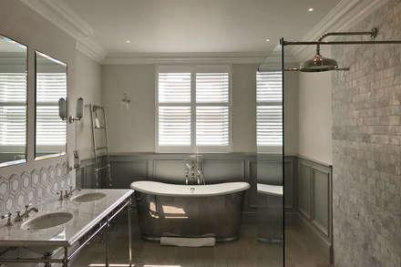 Full Height Shutters in a Bathroom: classic Bathroom by Plantation Shutters Ltd