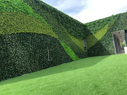 Artificial vertical garden wall creation with artificial hedges:  Commercial Spaces by Sunwing Industries Ltd