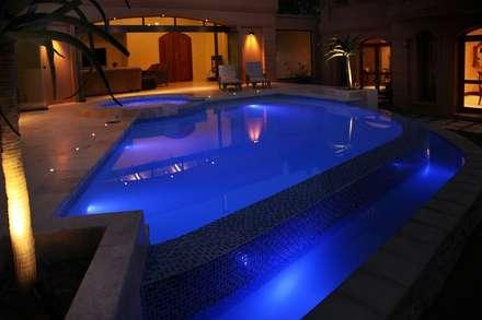 Villa Torino: modern Pool by Vision Tribe