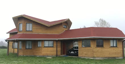 Log cabin by Nomade Arquitectura y Construcción spa