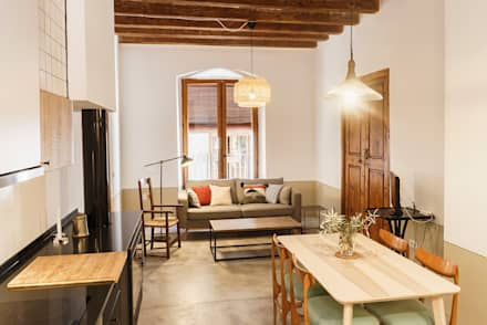 Rehabilitación Casa de Campo: Salones de estilo rural de Arquivistes Estudi