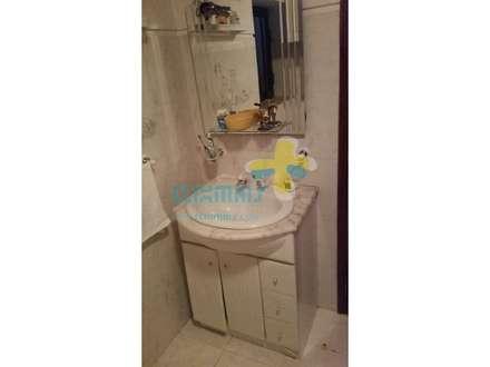 Casa de banho suite (1): Casas de banho rústicas por Clix Mais