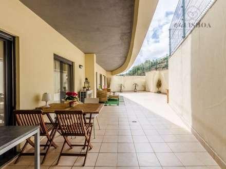 Apartamento T2 Odivelas: Terraços  por EU LISBOA