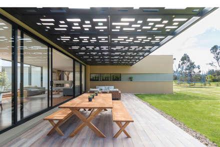 Casa el Molino: Terrazas de estilo  por David Macias Arquitectura & Urbanismo