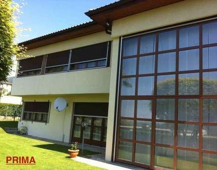 RISTRUTTURAZIONE VILLA IN CANTON TICINO: Casa unifamiliare in stile  di Studio Architettura Macchi