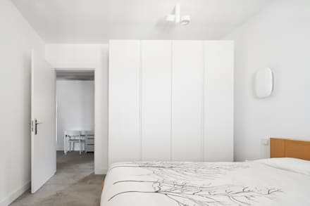 CASA JÚLIA: Dormitorios de estilo escandinavo de GUILLEM CARRERA arquitecte