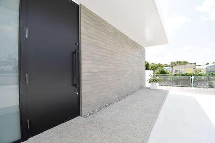 外壁: 有限会社 秀林組が手掛けた壁です。